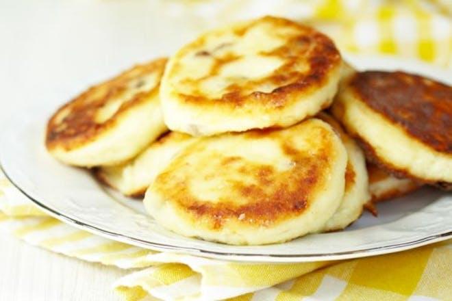 Mini cheesy pancakes on a plate