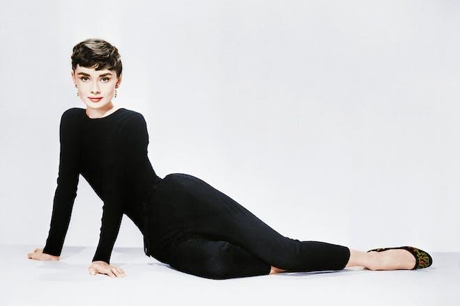 Audrey Hepburn reclining on floor