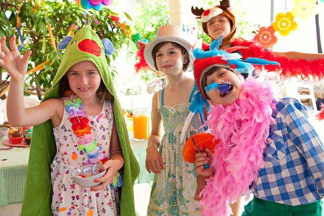 Kids dancing wearing fancy dress