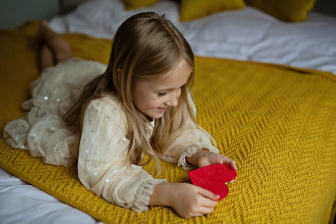 Little girl with love heart