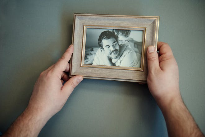 Picture of father and child in photo frame