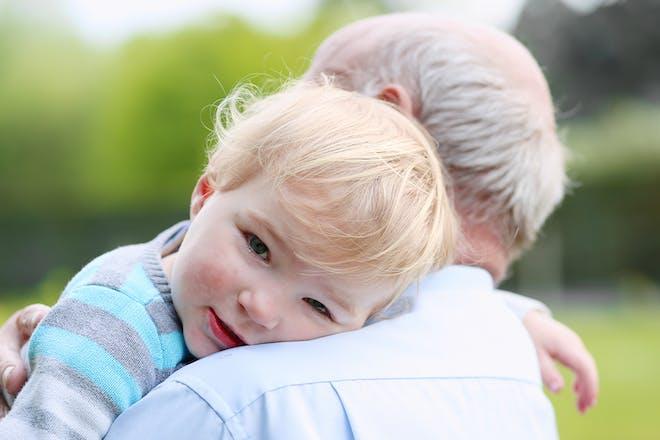 Grandad holding toddler
