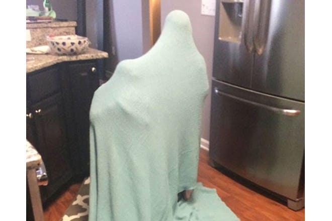children hiding under sheet