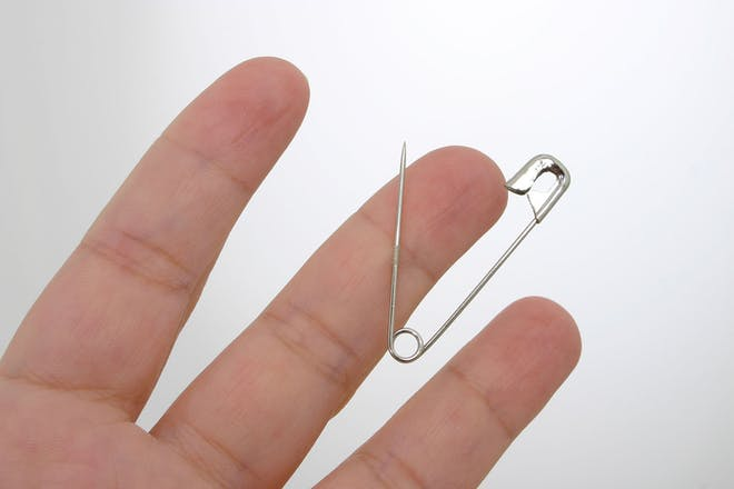 safety pin through thick skin of finger