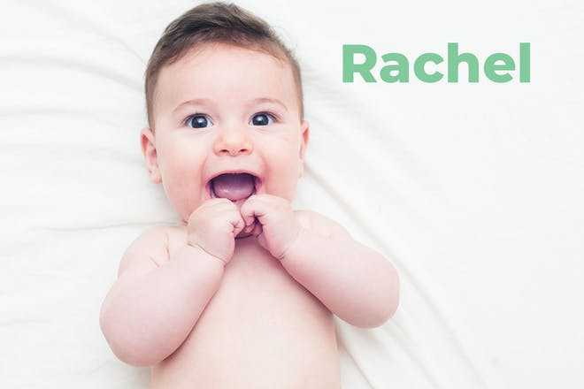 Baby lying down with hands near mouth. Name Rachel written in text