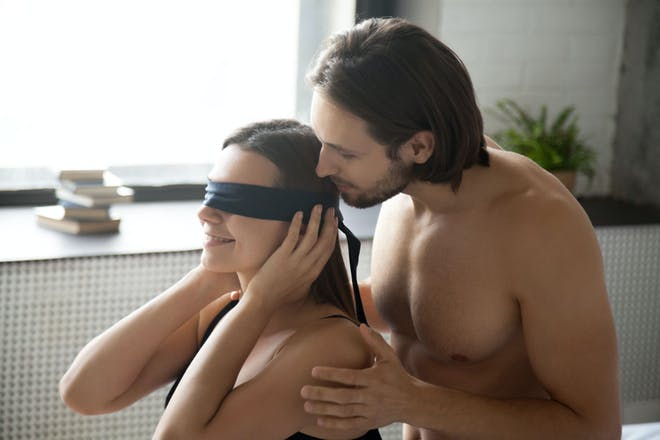 Blindfolded woman and man