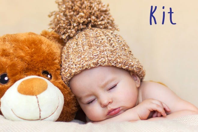 baby boy in woolly hat with teddy