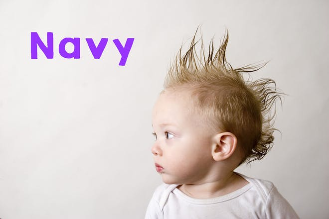 Baby with sticky up hair. Text says Navy