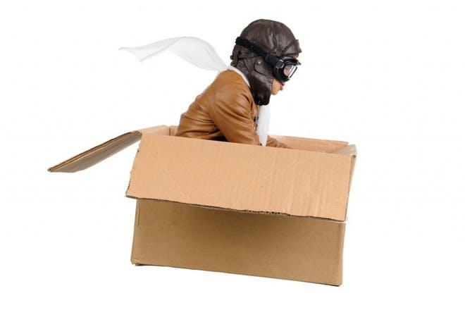 child flying in box
