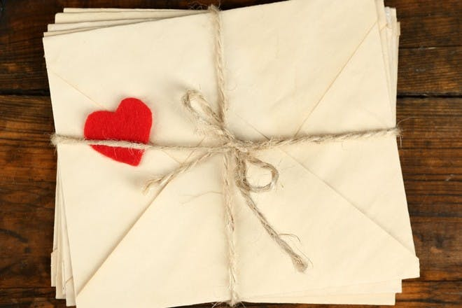 letters tied up in string with a love heart