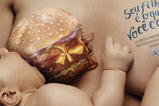 baby breastfeeding from burger breast