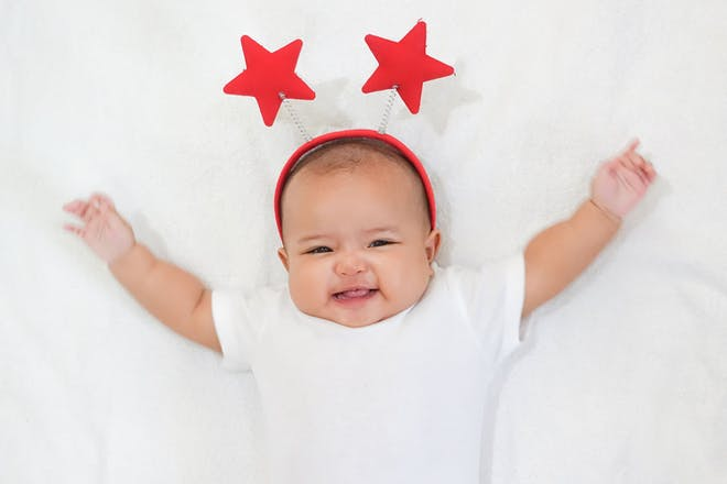 Baby wearing a red star headband