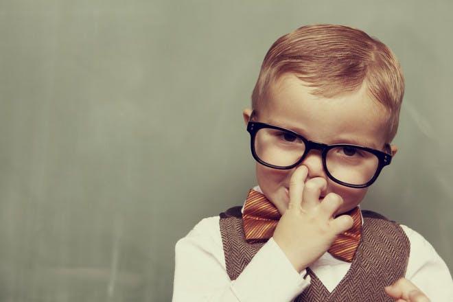 Child picking his nose