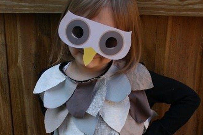 Little girl dressed as an owl