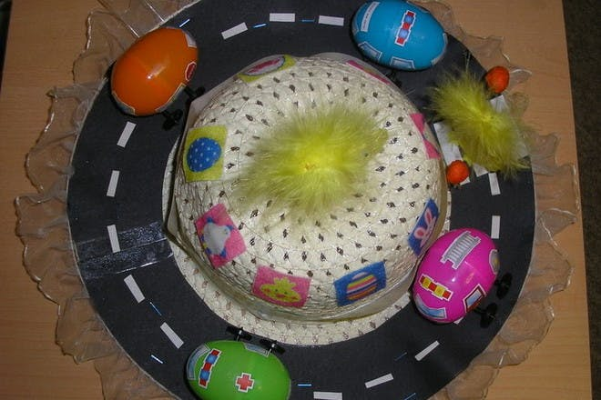 easter hat decorated to look like a road with egg cars