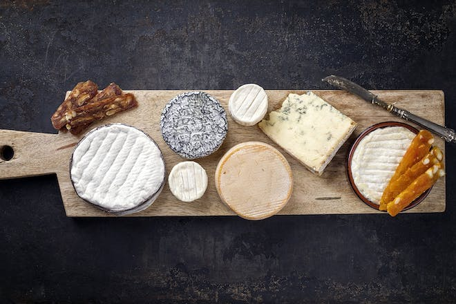 Selection of cheeses on a board