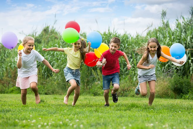 Kids running with balloons