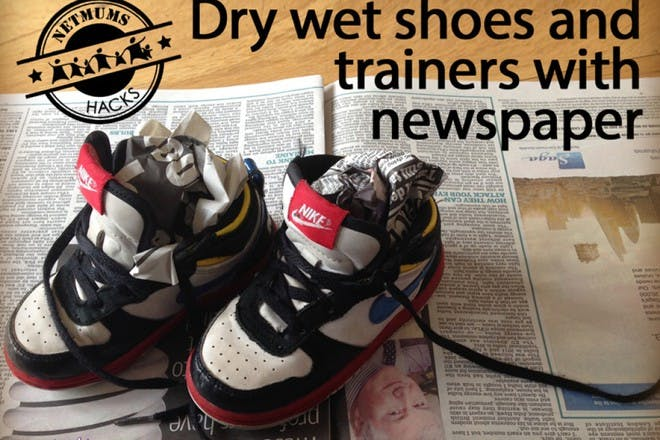 black and white trainers on newspaper