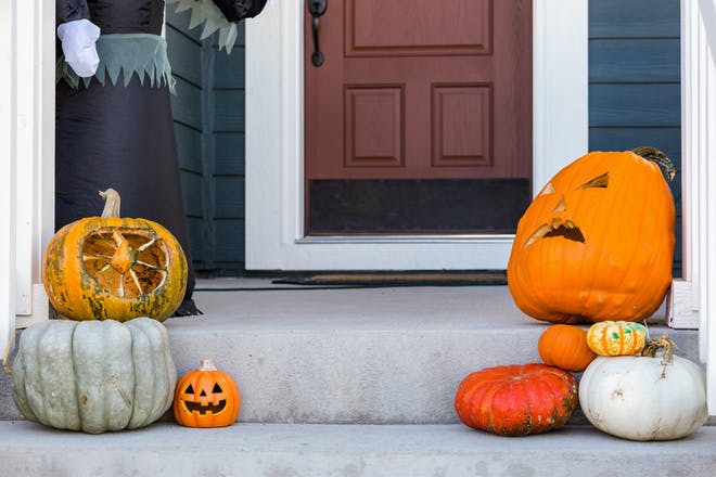 House decorated with pumpkins