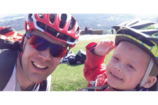 boy and father wearing bike helmets