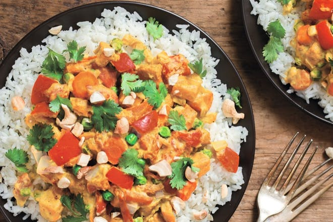 Creamy veg curry with cashew nuts on rice