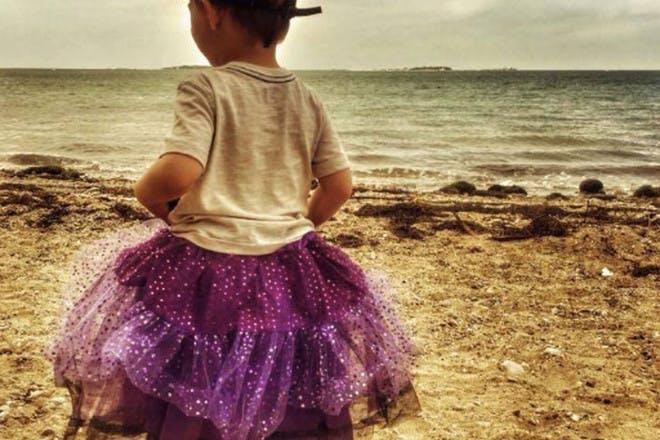 Boy pictured wearing sparkly tutu