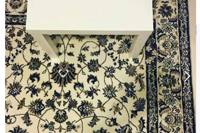 table on flower pattern carpet