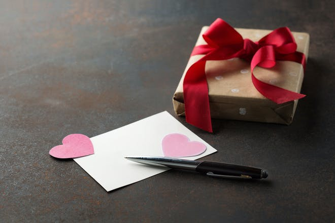 Blank Valentine's card and gift with paper hearts