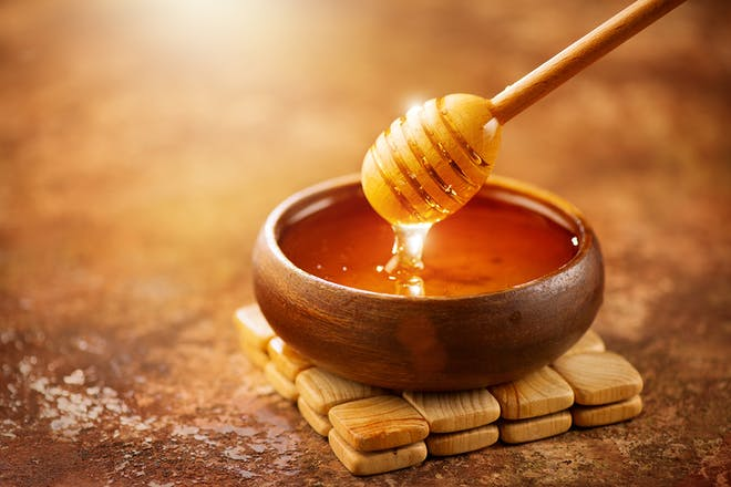 Honey and honey dipper