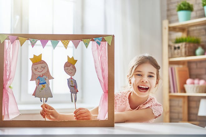 Girl doing puppet show with homemade puppets