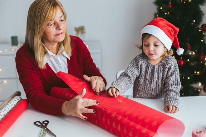 Mum and child wrapping a present