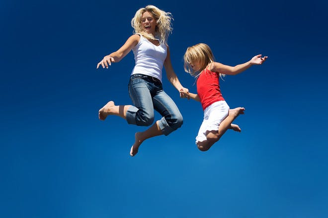Woman and child jumping