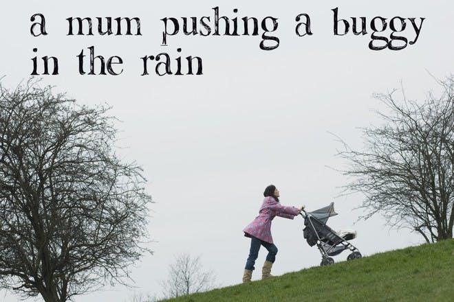 woman pushing buggy in rain