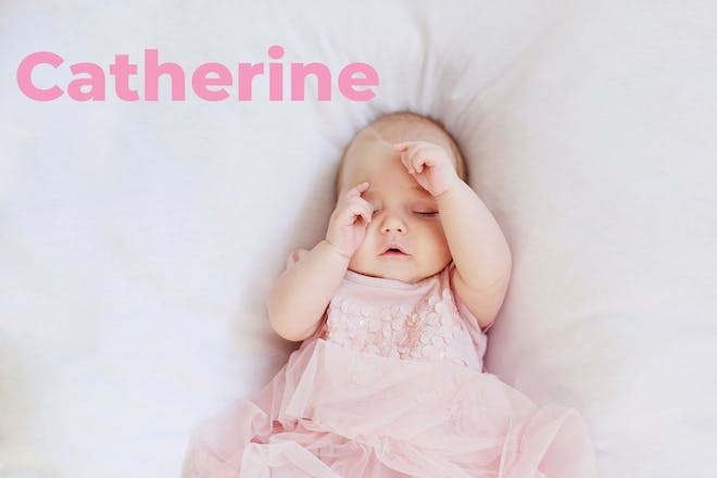 Baby in pink dress. Name Catherine written in text