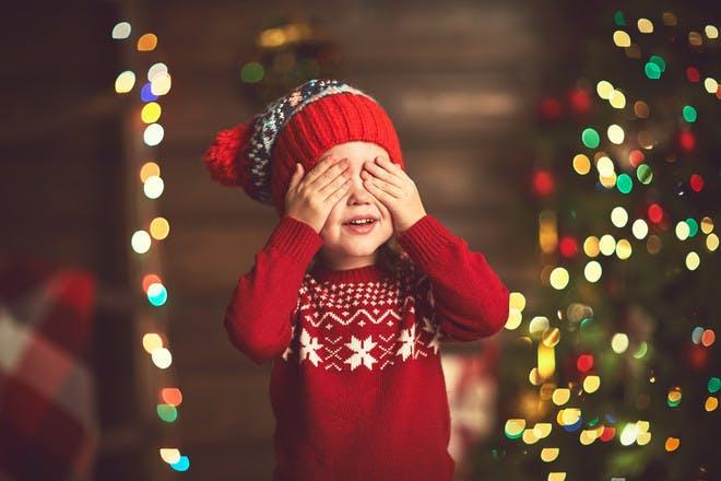 A child closing their eyes