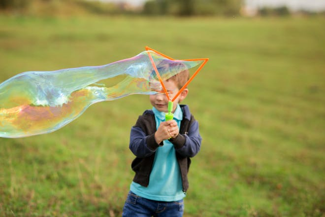 child with giant bubble