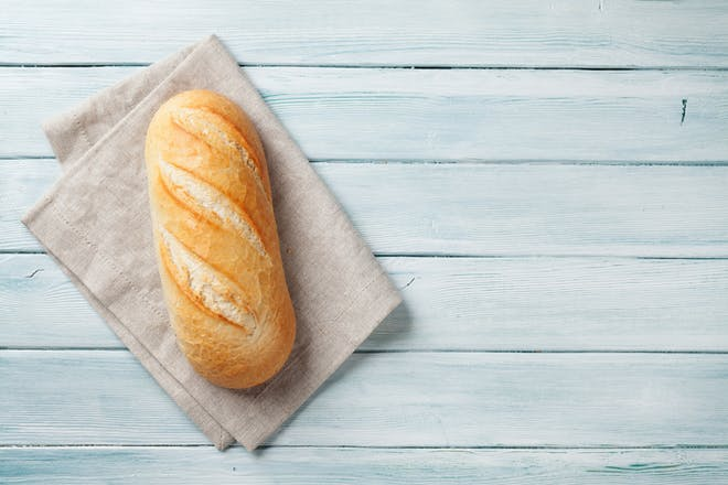 A piece of bread on a wooden table