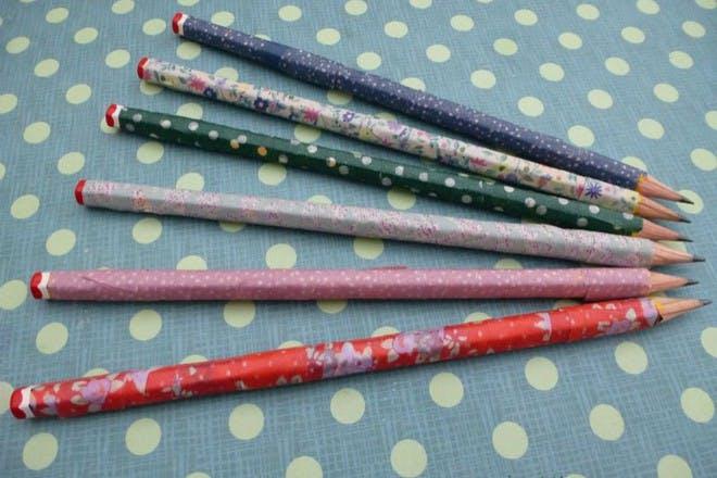 colourful washi pencils on patterned background