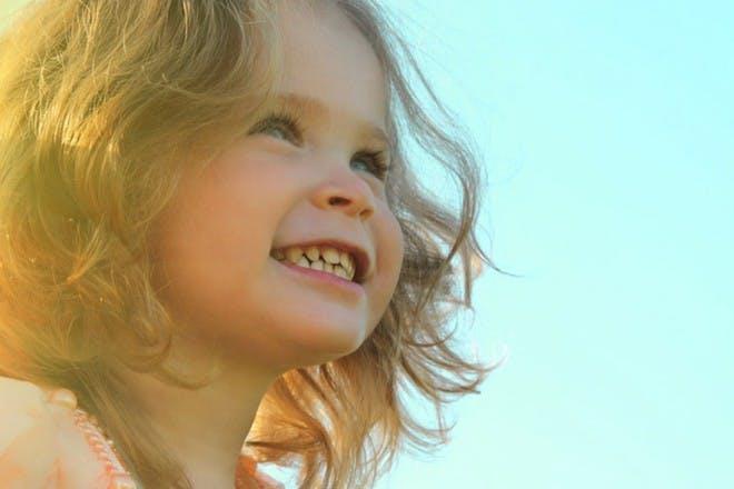 happy little girl in sunlight