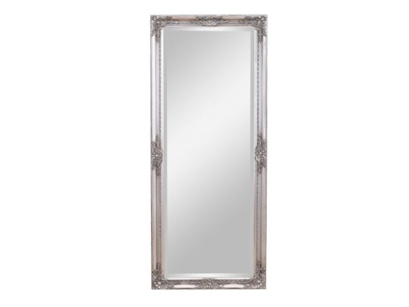 2. Place mirrors on walls that don't get natural light