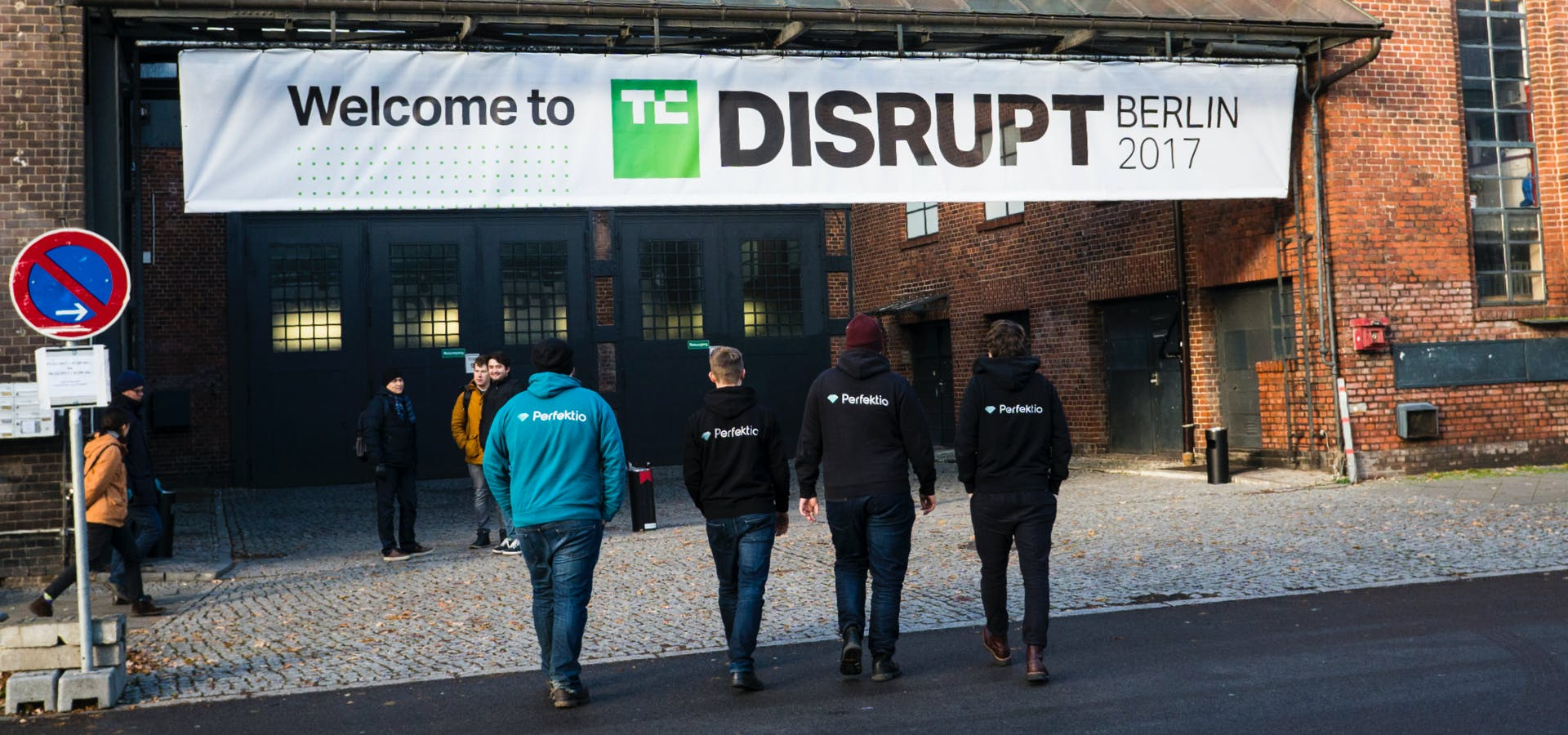 4 guys waling towards TechCrunch Disrupt Berlin venue