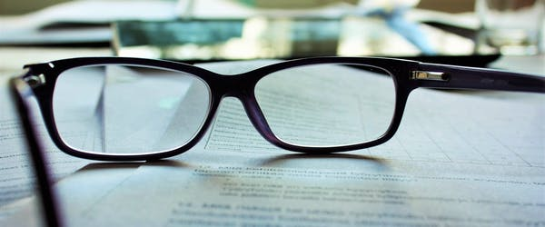 eyeglasses on top of a contract