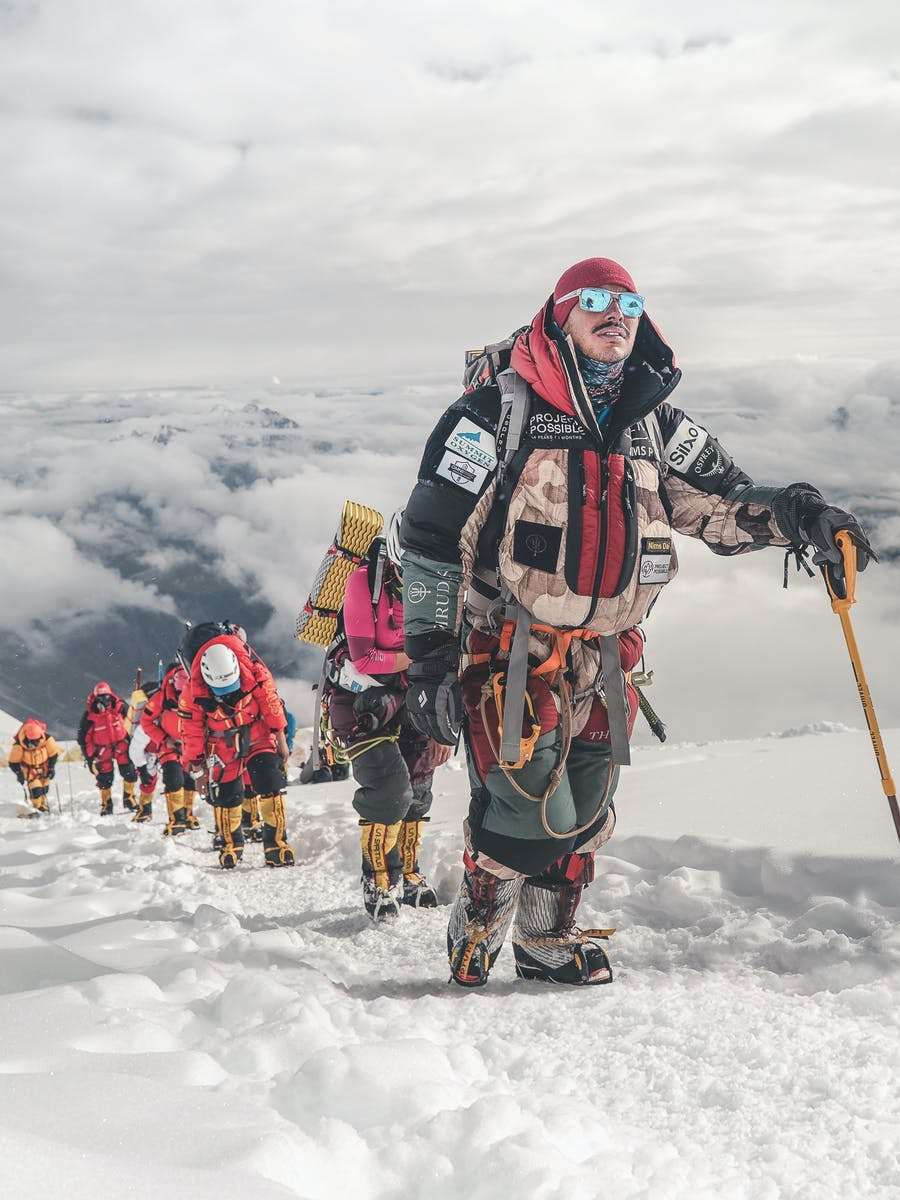 Nims leads a group expedition up to a high altitude summit