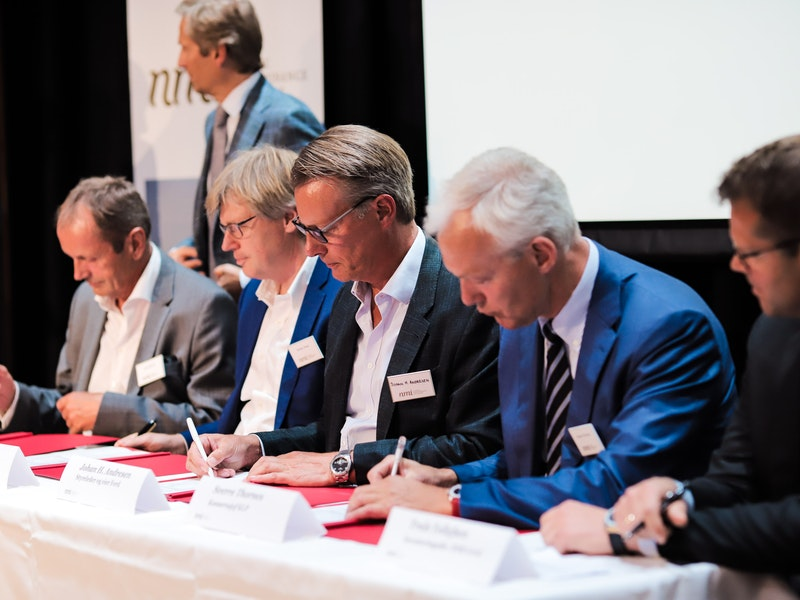 NMI celebrates 10-year anniversary with signing new, record-breaking fund