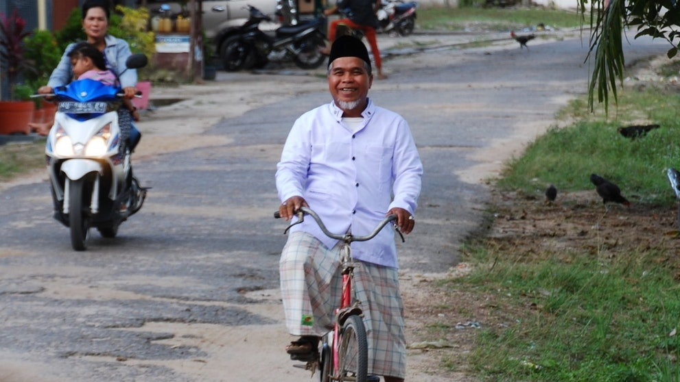 Man riding a bike, Indonesia