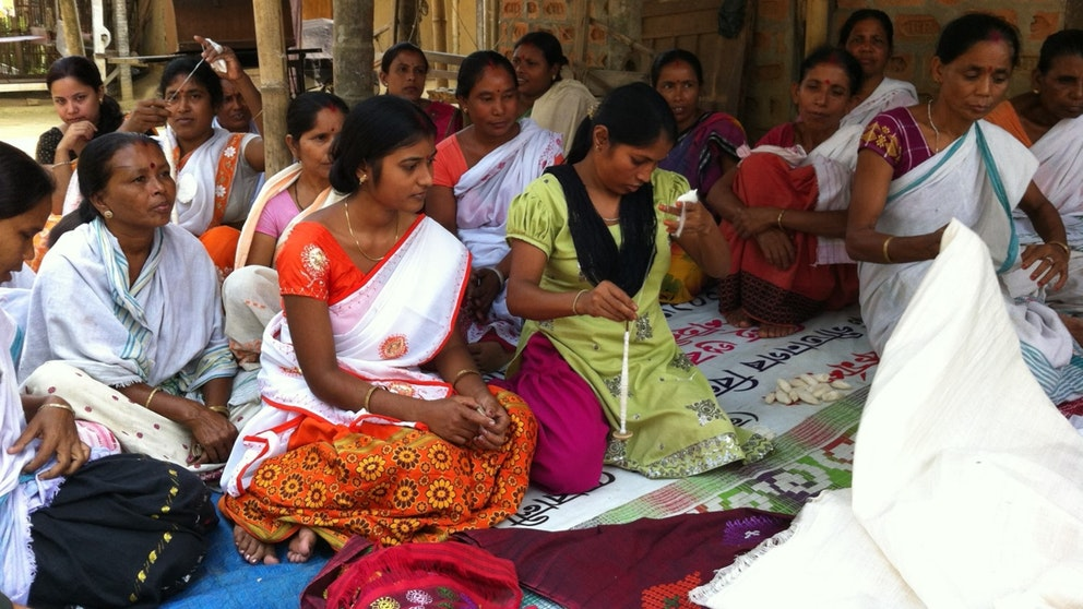 Women sitting at group meeting, India