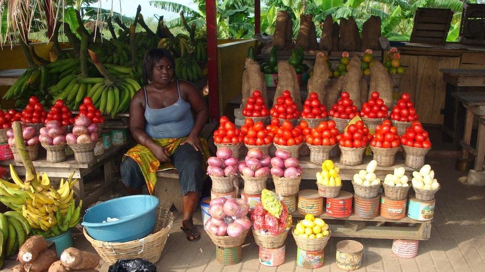 Woman selling vegetables, Ghana