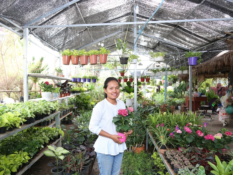 Young female entrepreneur who follows her passion in landscape design