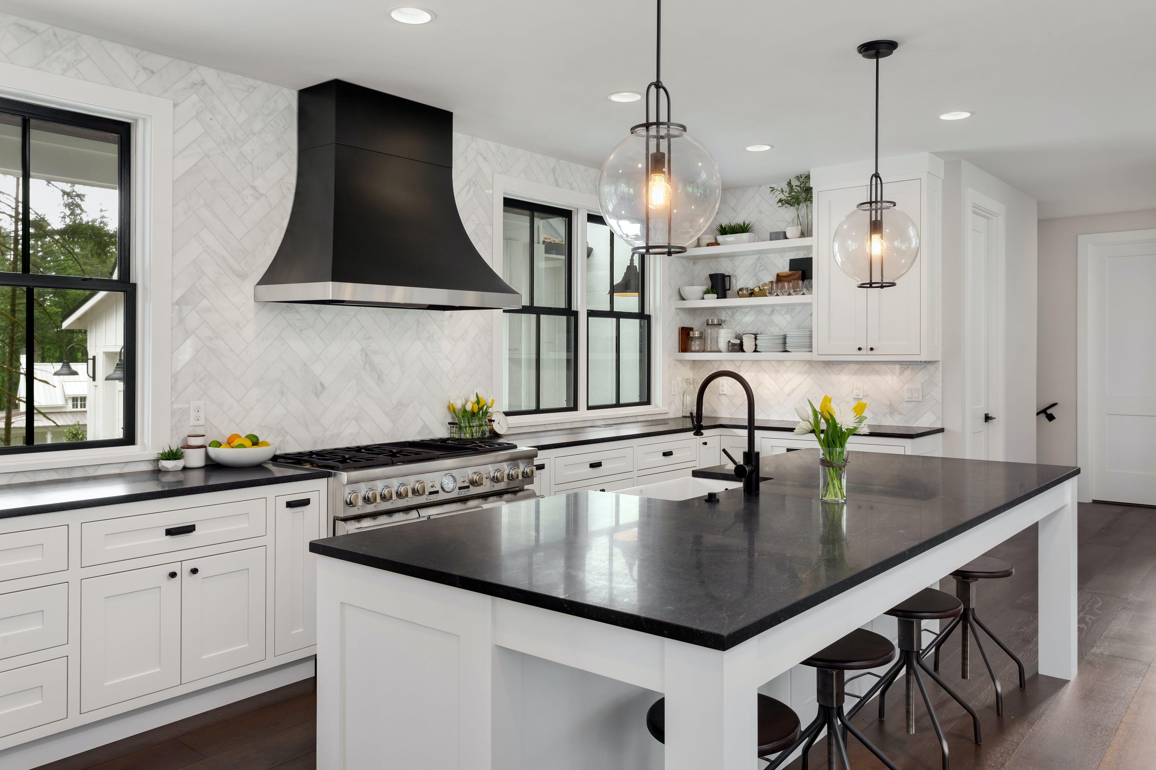 newly remodeled kitchen herringbone tiles