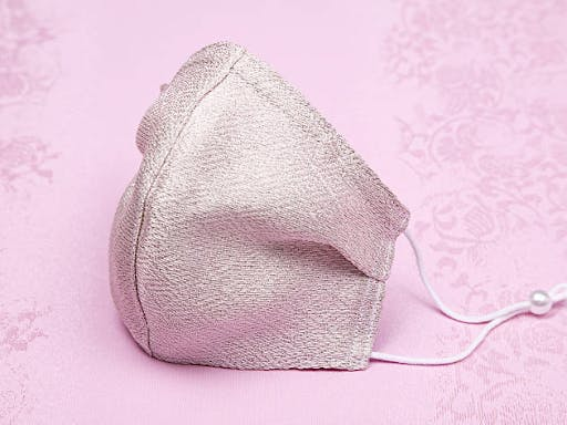 A pink Japanese face mask